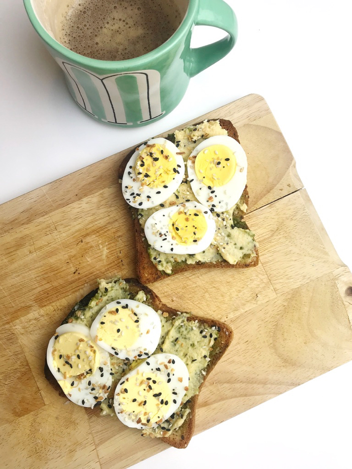 Multi-Grain Brown Rice Toast with Cashew Pesto, Hummus, and Hard Boiled Eggs Sprinkled with Everything But the Bagel Seasoning