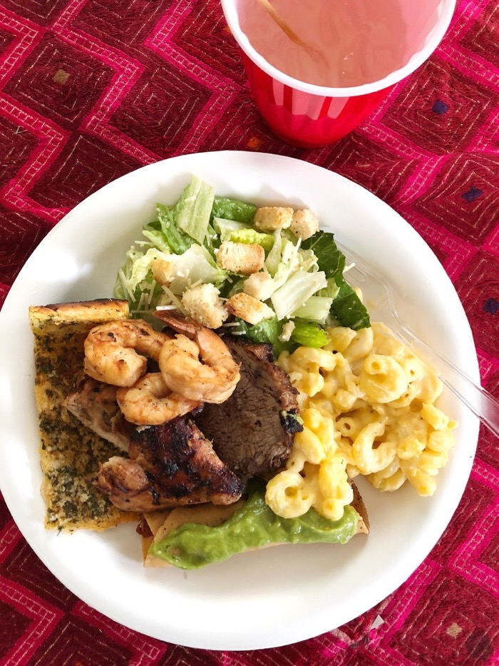 We had salad, chicken, shrimp, steak, mac 'n cheese, garlic bread and taquitos. Just fun BBQ food