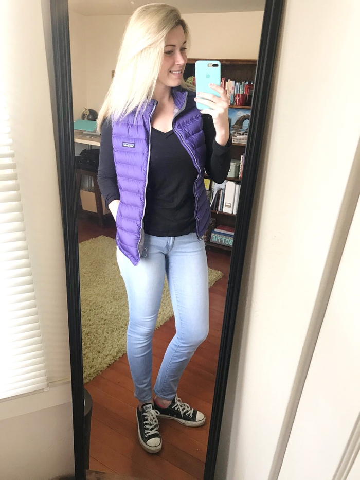 Easy 2-Minute Outfit. Patagonia Vest layered with Black Tee, Jeans, and Converse