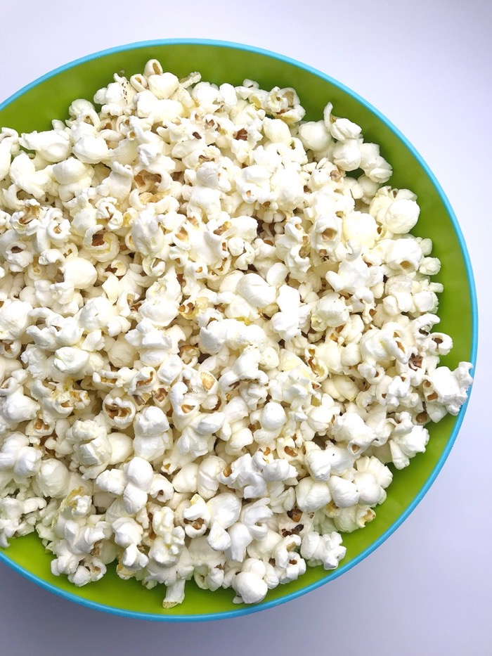 I snacked on a little bit of this popcorn and then wrapped the rest up in a Ziploc bag (it saves pretty well). I use organic kernels from Trader Joe's, cook it in coconut oil with sea-salt and toss it with a bit of olive oil once it's popped. Yum!