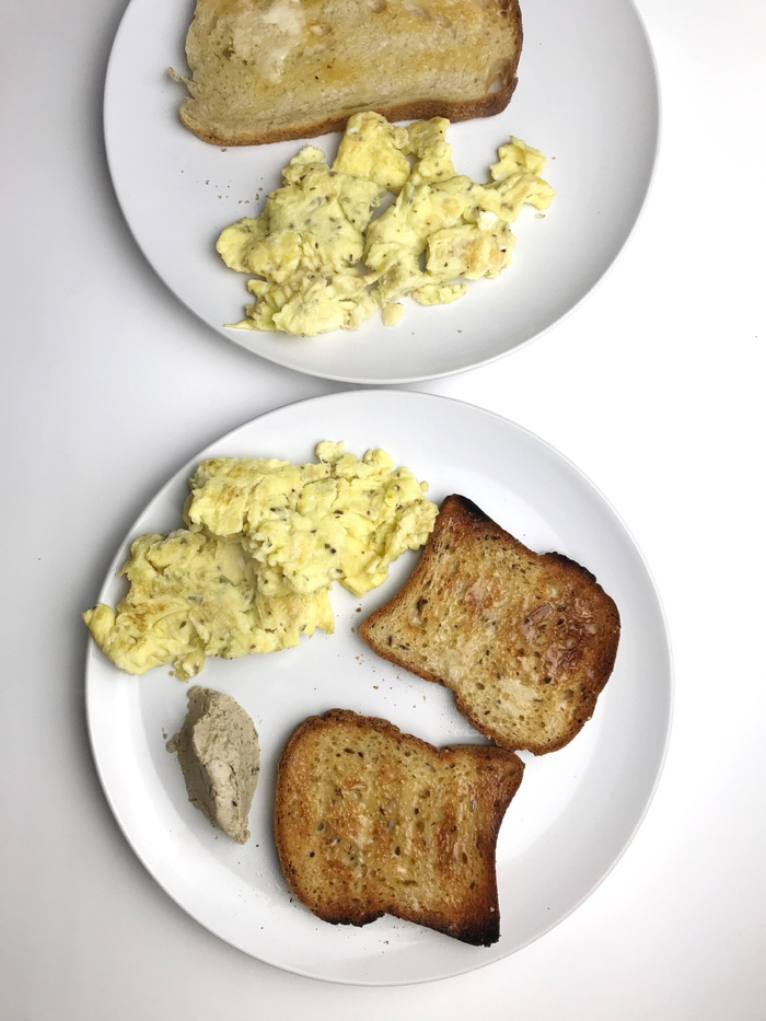 Two scrambled eggs, two slices of brown rice toast (sourdough for M) and olive hummus on the side (craving! for our breakfast).