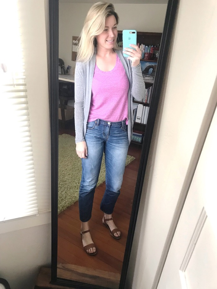 My Go-To California Summer Outfit. Plain Tee Layered with Gray Sweater, Jeans, and Brown, Leather Sandals.