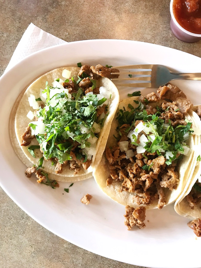 Three steak tacos with onion and cilantro. YES. Totally hit the spot.