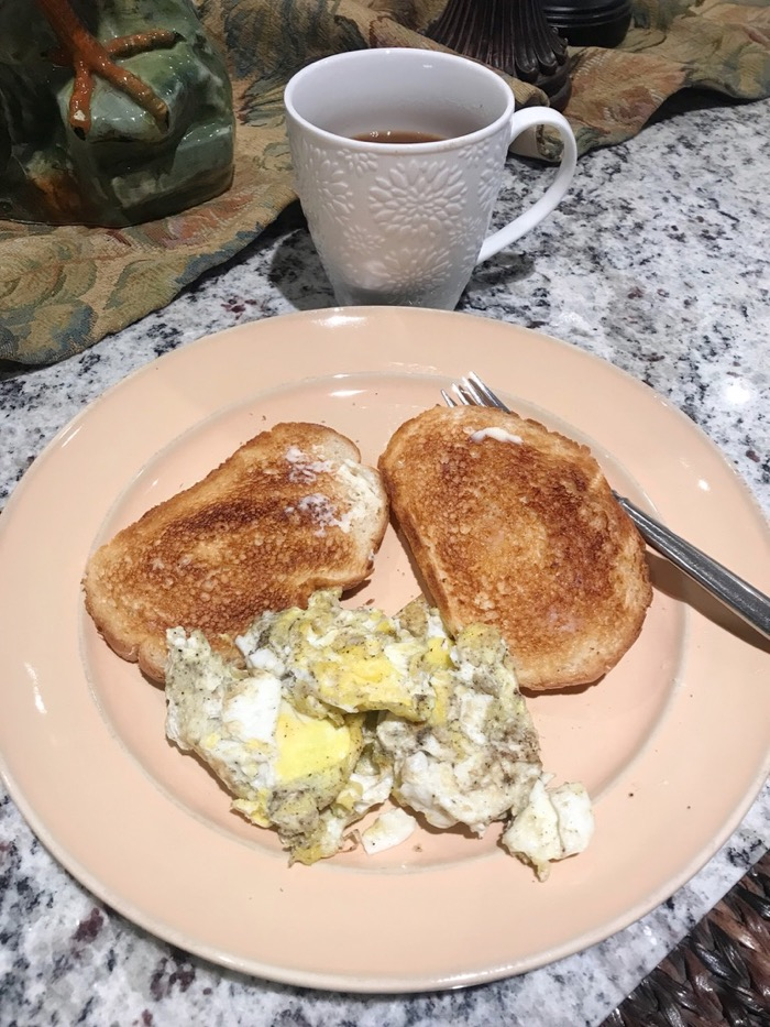 Scrambled Eggs with Salt and Pepper, Sourdough Toast, and Coffee with Almond Milk on the Side.