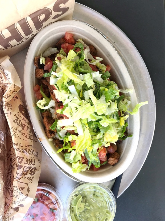 Brown Rice Bowl From Chipotle with Pinto Beans, Steak, Pico de Gallo, Lettuce and Guacamole. We got Chips on the Side and Enjoyed with Salsa