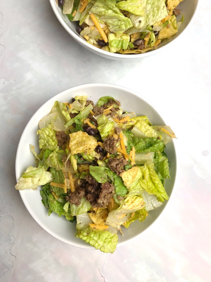 Taco Salad With Beef, Cheese, Romaine, Avocado, and Tortilla Chips