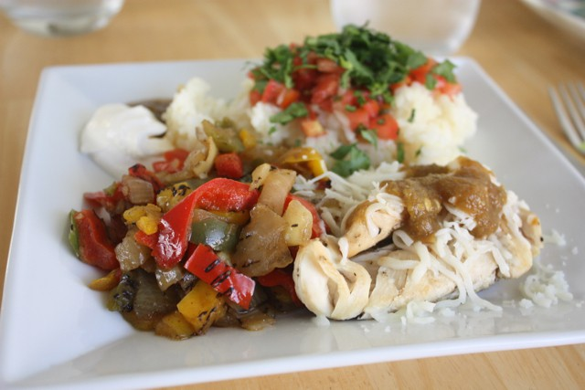 Chicken rice fajitas topped with cilantro, cheese, and salsa