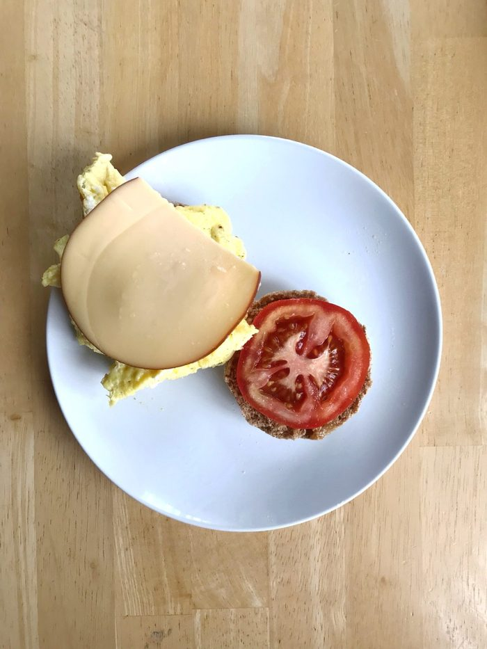 egg gouda tomato english muffin sandwich