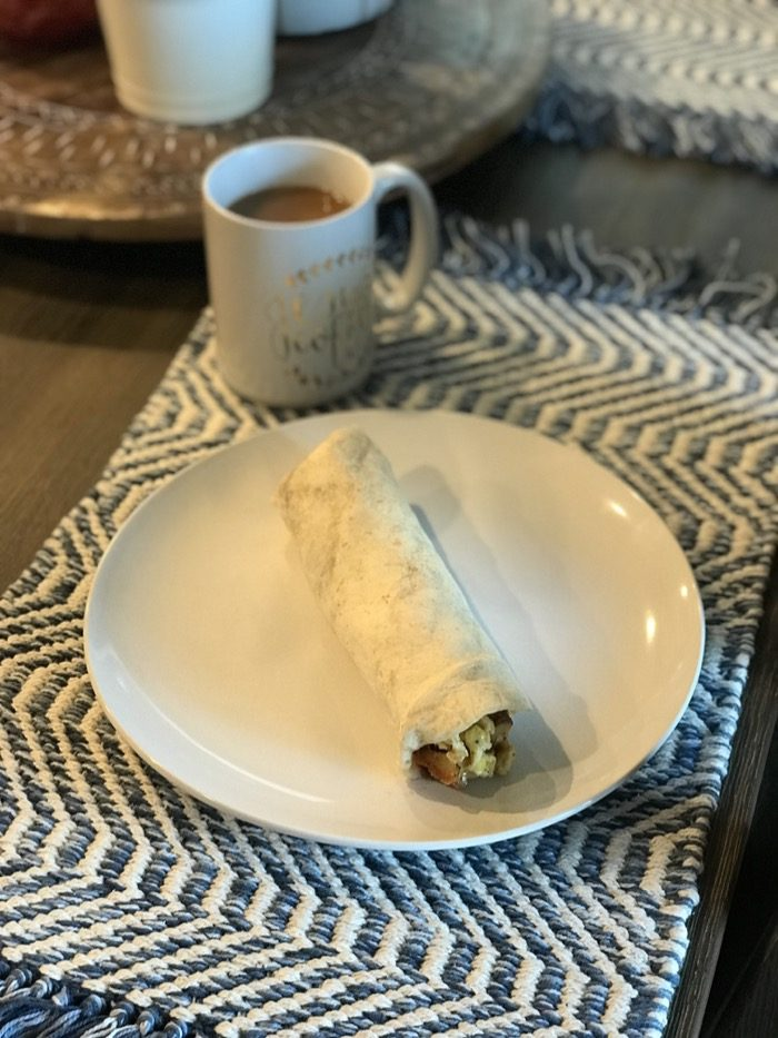 Breakfast Burritos with Eggs, Bacon, Potatoes, Cheese, and Avocado Inside.