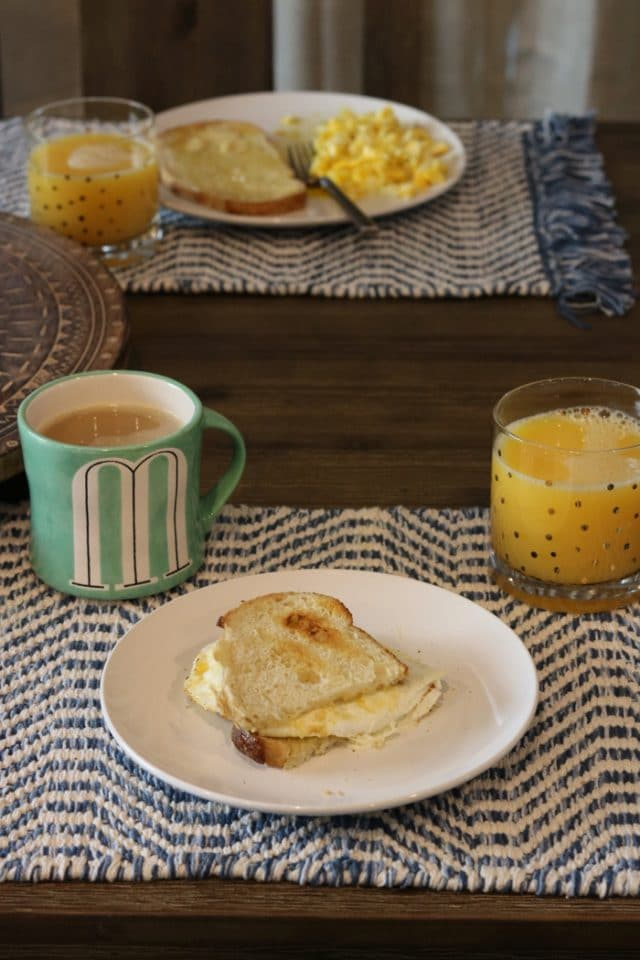 Eggs and Sourdough Toast for Breakfast With Orange Juice, Coffee, and Chlorophyll Water