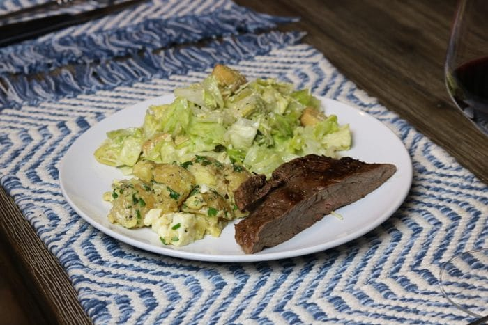 Steak, Potatoes With Vinaigrette, Parsley, Chives, Basil And Caesar Salad For Dinner Using the Recipe From the Cookbook Healthyish.