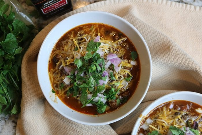 The Best Instant Pot Chili Recipe From Damn Delicious. We Topped it with diced red onion, cheese, and cilantro. Yum!