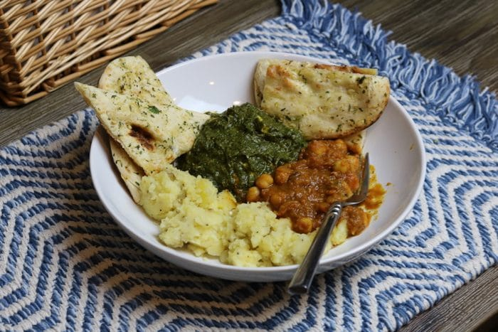 Garlic Naan Bread Toasted with Butter, Potatoes, and Trader Joe's Pre-made/Frozen Palak Paneer and Channa Masala.