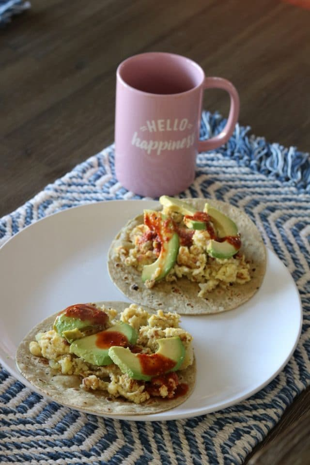 Breakfast Tacos With Eggs, Leftover Potatoes, Avocado, and Salsa.