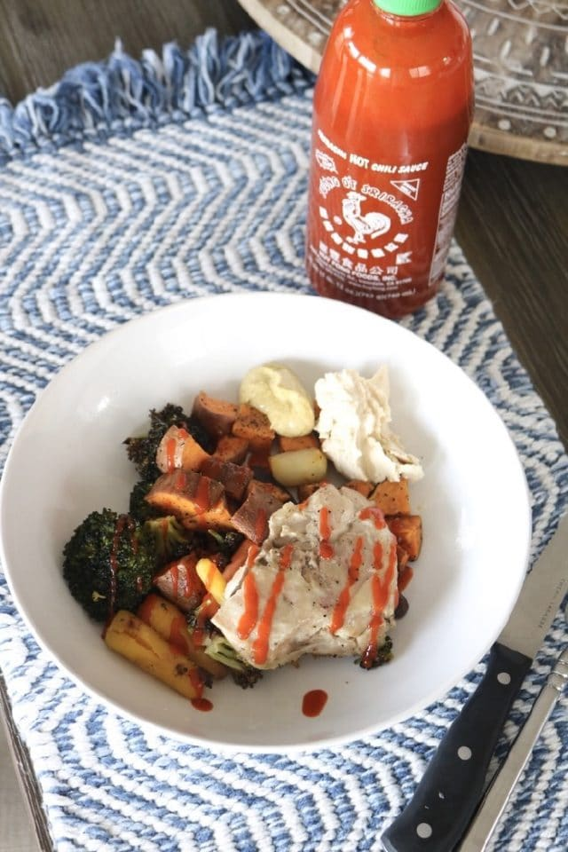 My go-to lunch during a busy work week | Roasted carrots, broccoli, sweet potatoes and chicken topped with Sriracha, hummus, and mustard aioli
