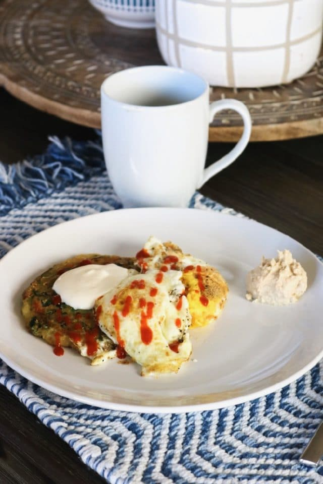 Saturday morning breakfast: Eggs with Trader Joe's Scallion Pancakes topped with sour cream and hummus