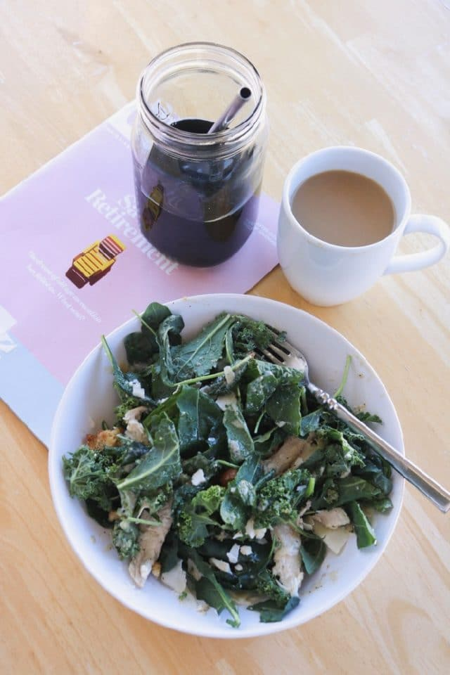Trader Joe's Organic Kale Chicken Caesar Salad with coffee and a magazine on our back patio.