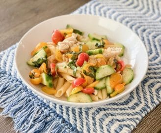 Daily Eats | Penne noodles dressed in olive oil, sea salt and garlic with grilled chicken and a mixture of tomatoes, cucumber, basil, red wine vinegar, and olive oil. Balsamic glaze drizzled on top.