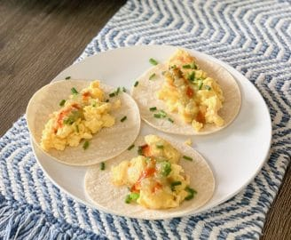 Simple, at-home Saturday brunch | Eggs and corn tortillas with cheese, chives, and salsa.