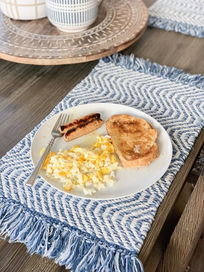 Sourdough toast with scrambled eggs and chicken sausage. Yum!