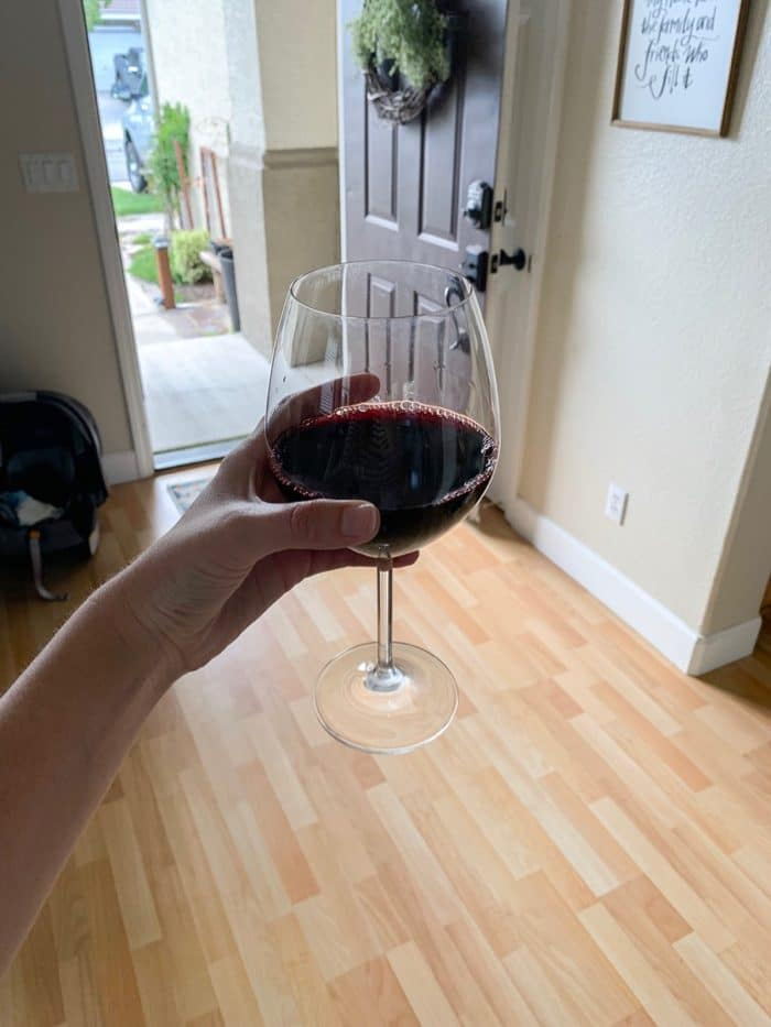 A glass of wine waiting for me at our friends' after I got off work.