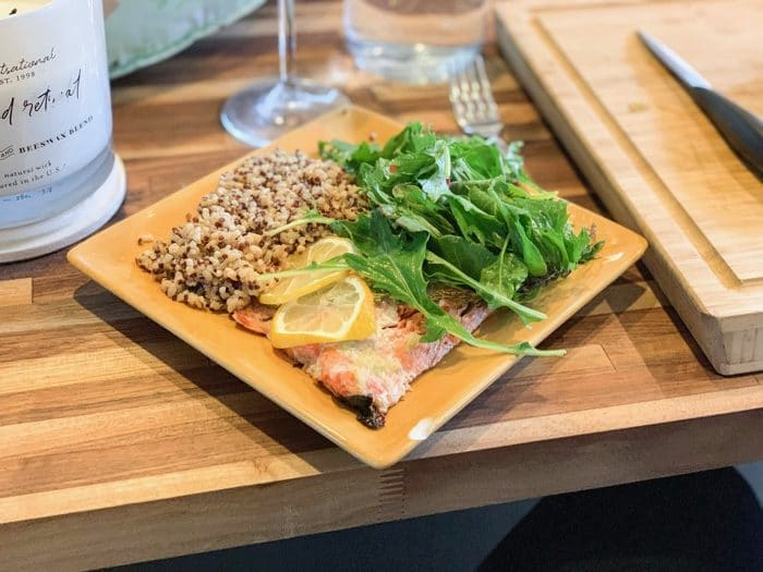 Daily Eats | Salmon, quinoa, and arugula salad with wine.