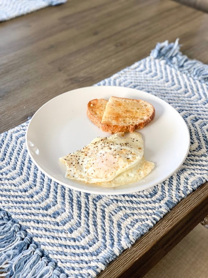 Daily Eats   Two over-medium eggs with a slice of toasted sourdough topped with Kerrygold butter. Yum!