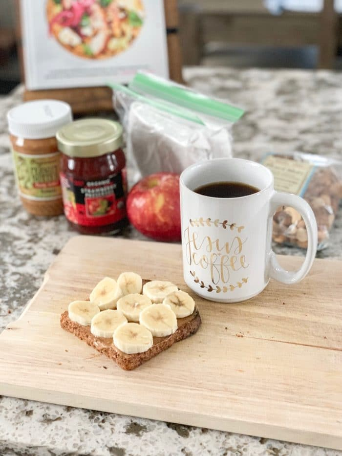 Sunday morning breakfast | Ezekiel toast with Organic creamy PB from TJ's (yes, salted) and banana with a cup of coffee.
