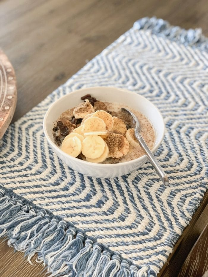 Daily Eats | Trader Joe's bran flakes, raisins, banana, flaxseed, and almond milk. Oh, and a little swirl of agave to give it just the right sweetness.