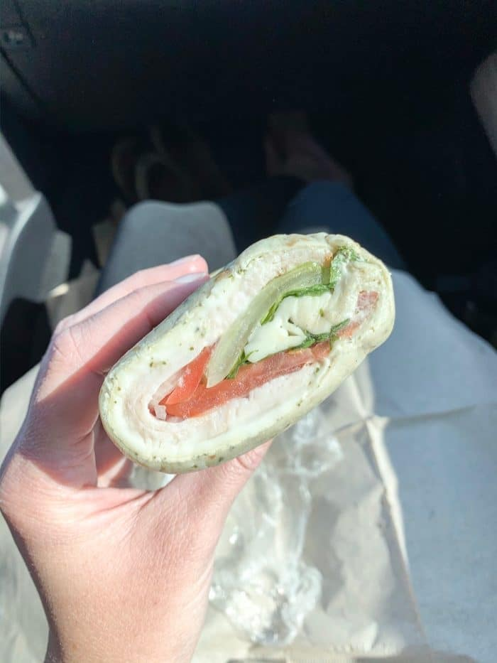 This wrap has pesto, turkey, provolone, tomato, lettuce, and pesto.