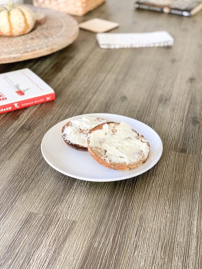 We had cinnamon/raisin bagels in the freezer, so I took one out, toasted it, and topped it with cream cheese.