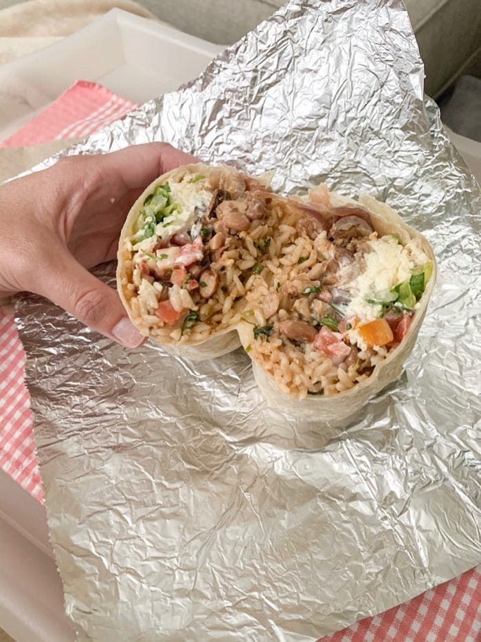 Chipotle order: chicken burrito with brown rice, pinto beans, pico, sour cream, cheese, and lettuce.