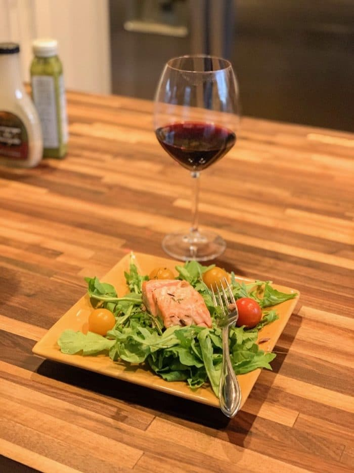Salmon on a bed of arugula with cherry tomatoes. This was such a GREAT combination. I had a glass of wine with it