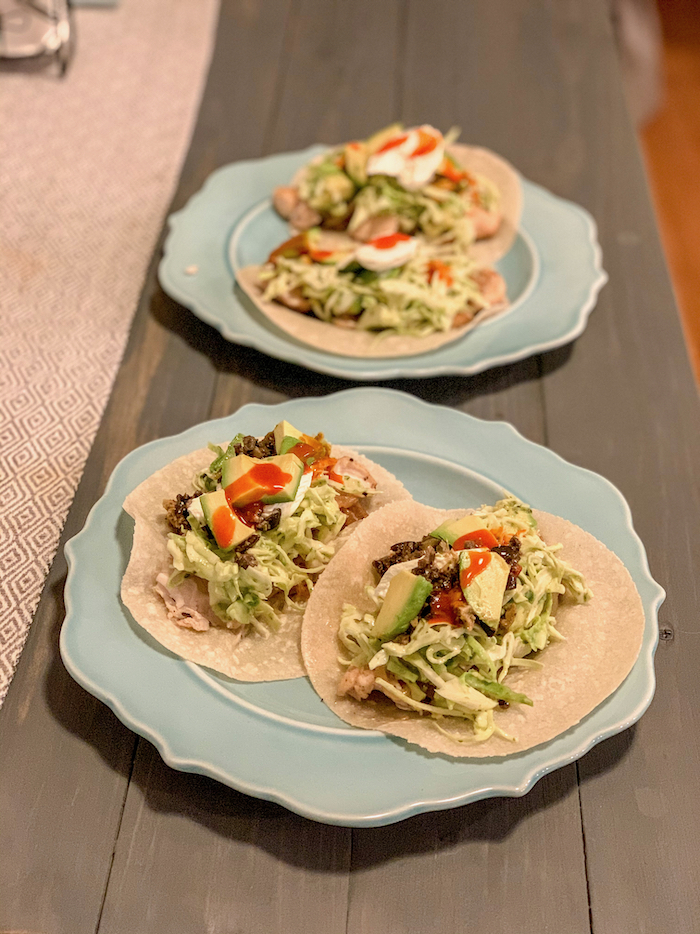 Chicken tacos on Siete tortillas with chicken (cooked with olive oil, onion, and garlic), cabbage, cilantro dressing, avocado, sour cream, and for me... olive tapenade