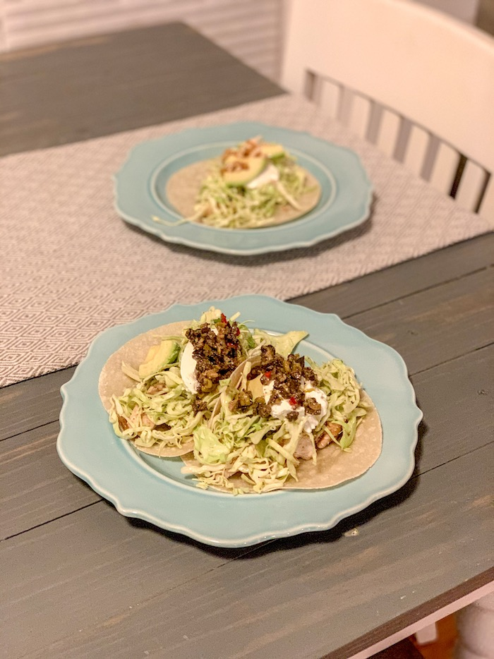 Mixed up some fresh cabbage with cilantro dressing, heated the chicken and tortillas