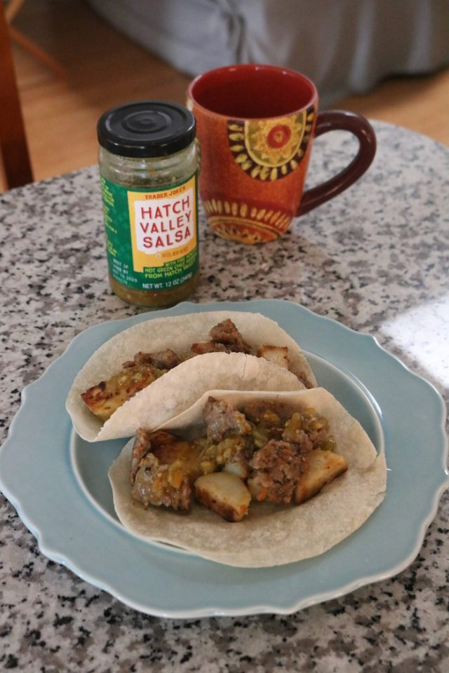 two Siete tortillas, ground breakfast sausage and potatoes with green salsa.