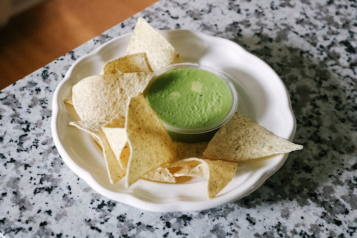 Snack plates of Siete chips and guacamole