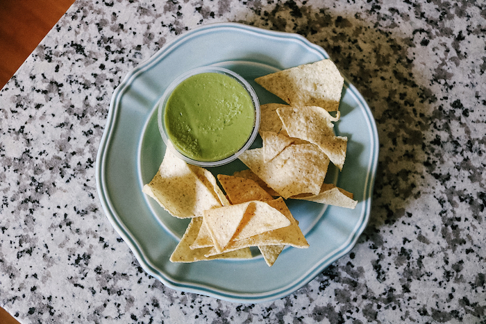 Little plate of Siete chips and guac