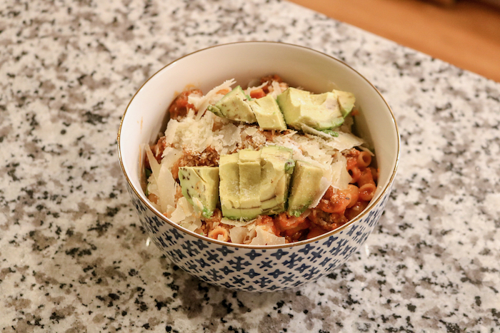 brown rice elbow pasta with ground beef and marinara sauce (I use Rao's sensitive sauce). In my bowl, I added a handful of arugula, avocado, and parmesan cheese