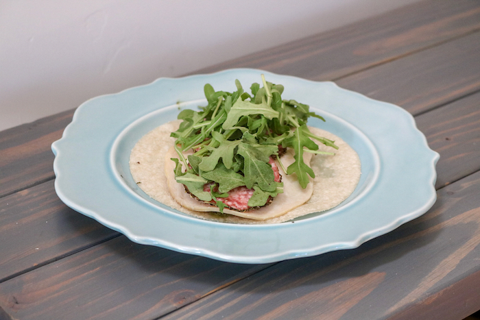 simple wrap: a Siete tortilla (cassava flour), pesto, turkey, salami, avocado and arugula.
