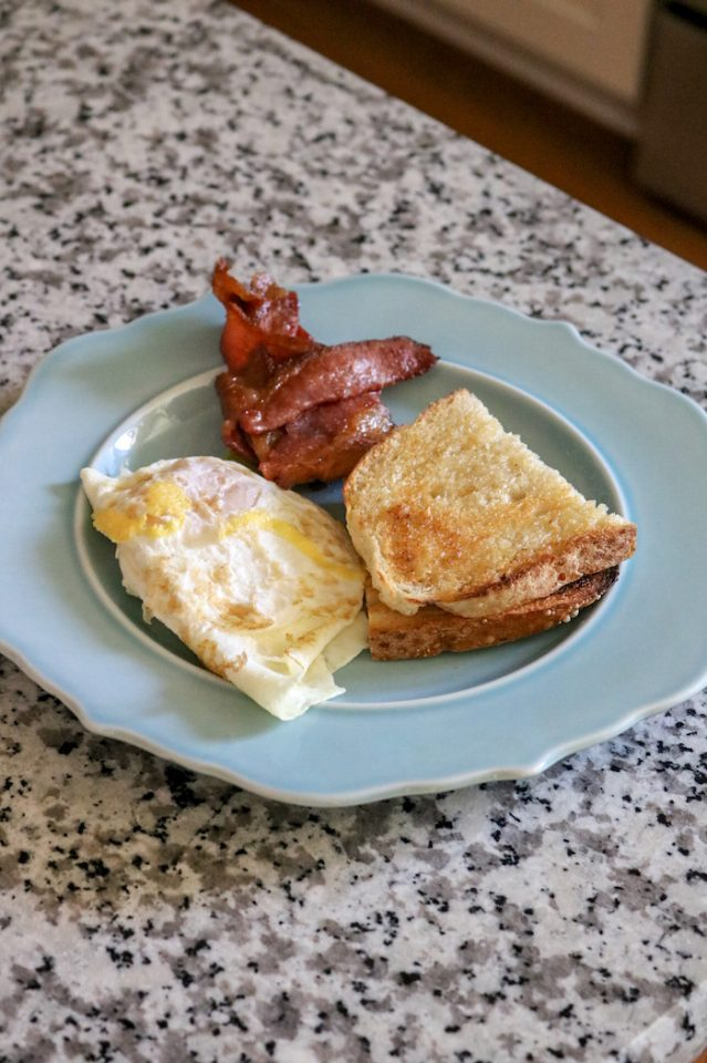 Two eggs, two slices of leftover bacon (easy!) and a slice of sourdough.