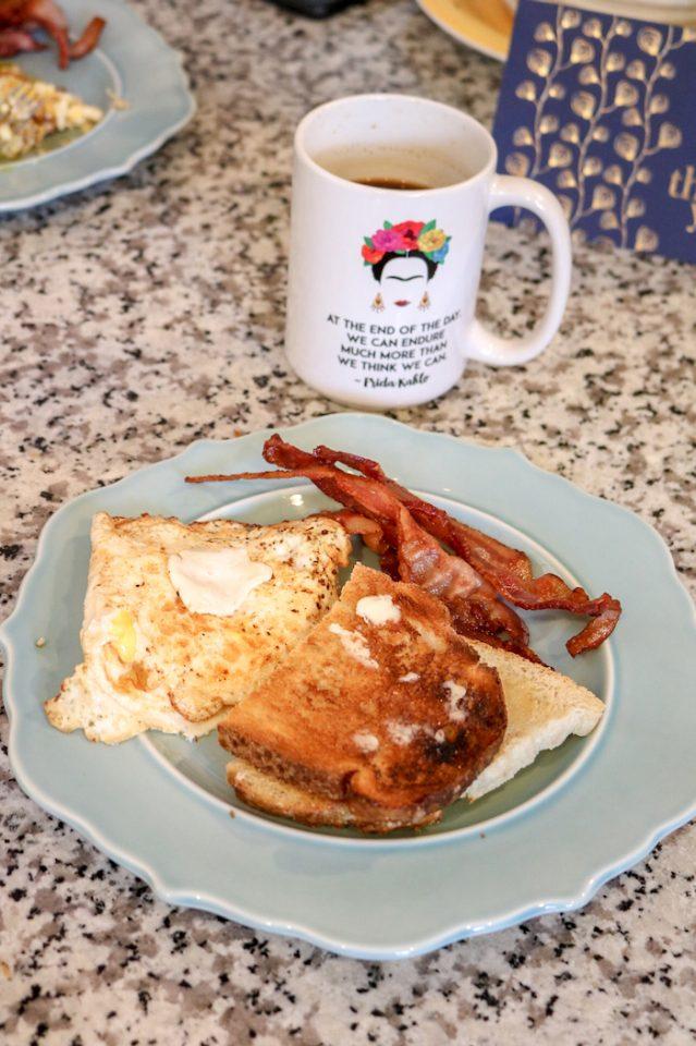 Eggs, toast, bacon, and coffee. Mmm!