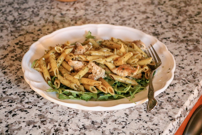 Pasta with pesto and chicken.