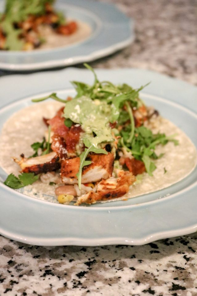 Big chicken taco on a Siete tortilla. We had a few tortilla chips with this as well. We made a microwave rice/beans bowl and mixed it with the chicken I BBQ'd. We added leftover bacon from breakfast, cilantro, and cilantro dressing from TJ's.