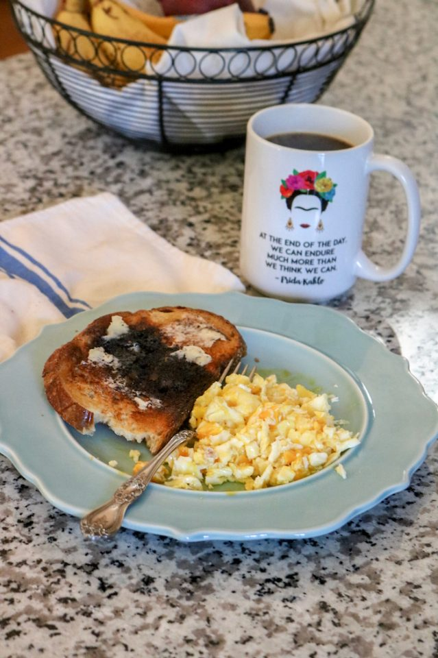 Two eggs over-medium, sourdough toast (had to toast, flip, and toast some more, so the middle burnt - I don't mind) with coffee