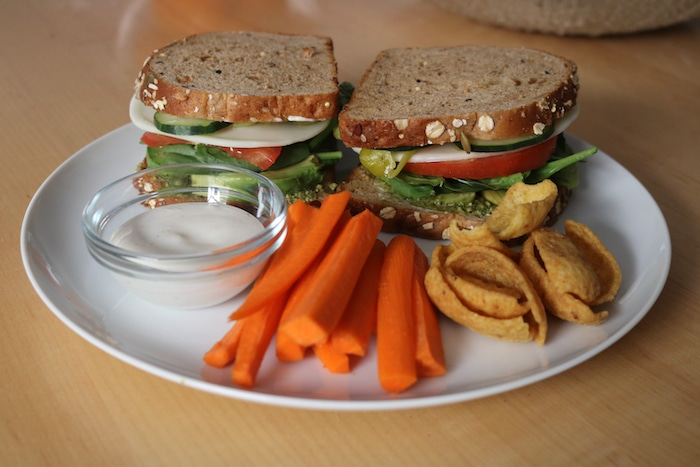 Made a veggie sandwich for lunch. It sounded so good. This is exactly like the veggie sandwich my friend Corrine (who is also preggo) and I got at the lake on Monday. Soooo good. I ate a few of the carrots with ranch and Fritos