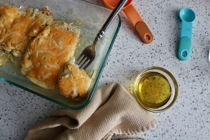 Leftover chicken enchiladas I'd made this week and ate that small half piece.