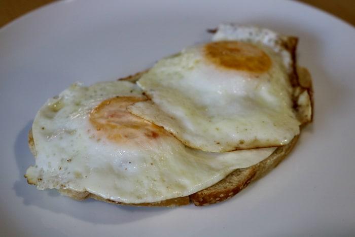 Two over-medium eggs on toast