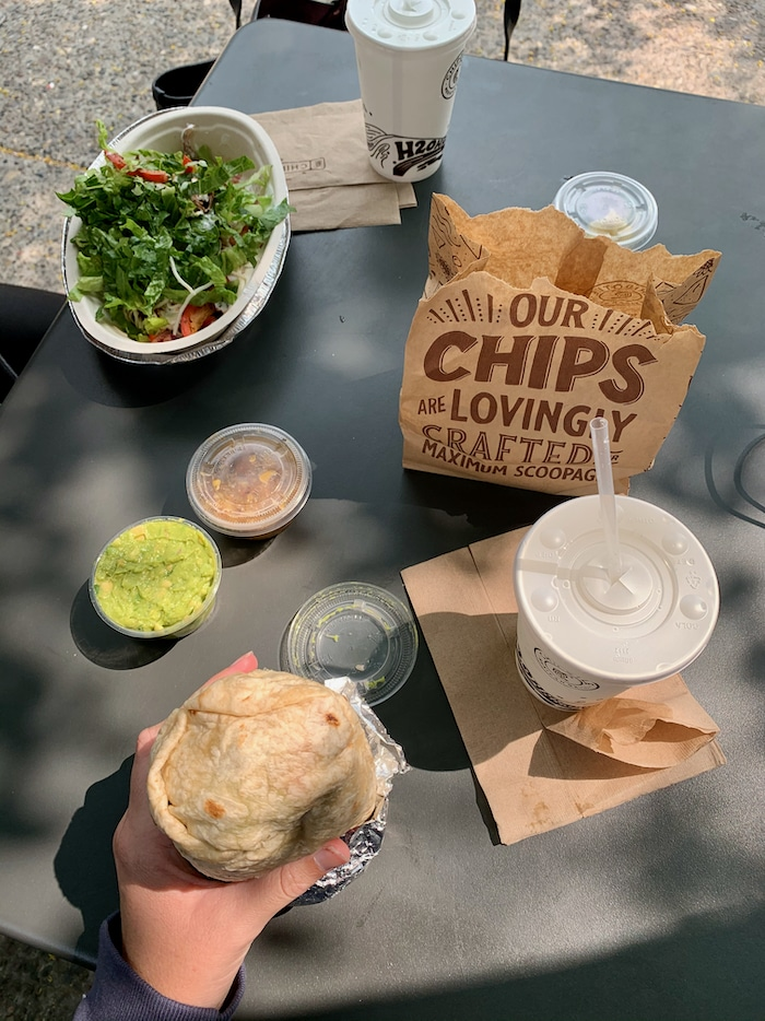 Chipotle order-I got a veggie burrito with black beans, brown rice, fajita veggies, guac, sour cream, cheese, and lettuce. YUM. YUM. YUM. We shared chips and guac on the side. And iced water with lemon (tastes so good lately!).