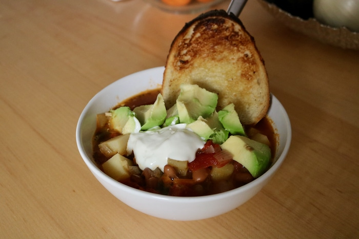 I heated up some veggie soup and topped it with avocado, sour cream, and half a slice of buttered sourdough toast.